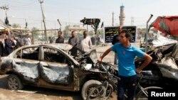 Pamje pas një sulmi të mëparshëm në një lagje të Bagdadit