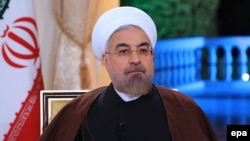 "Iranian President Hassan Rohani said that the talks made positions ""closer."""