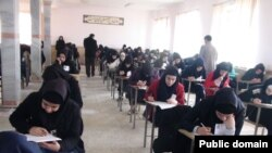 Iranian students take part in a state university entrance exam. Undated