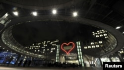 The 15x17-meter neon heart was lit above the entrance of the Altiero Spinelli building of the European Parliament in Brussels on December 17, the eve of the first anniversary of Vaclav Havel's death.