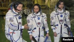 ISS crew members (left to right) U.S. astronaut Daniel Burbank and Russian cosmonauts Anton Shkaplerov and Anatoly Ivanishin train at the Baikonur cosmodrome in November.