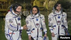 U.S. astronaut Daniel Burbank and Russian cosmonauts Anton Shkaplerov and Anatoly Ivanishin (left to right) during training at the Baikonur cosmodrome in early November.