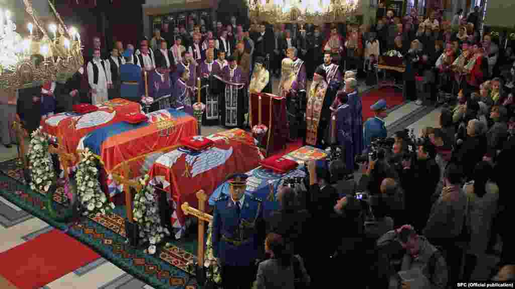 The four coffins of the Karadjordjevic family, former Yugoslavia's royal family, lie inside Belgrade's Congregational Church on May 24 during a religious ceremony. They were to be reburied in the crypt of St. George's Church, the resting place of their ancestors in Oplenac.