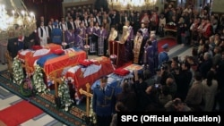 The coffins of the Karadjordjevic family, former Yugoslavia's royal family, lay inside Belgrade's Congregational Church during a religious ceremony before being reburied in Oplenac.