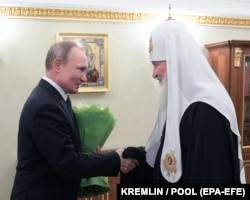 Президент Росії Володимир Путін і Московський партіарх Кирило