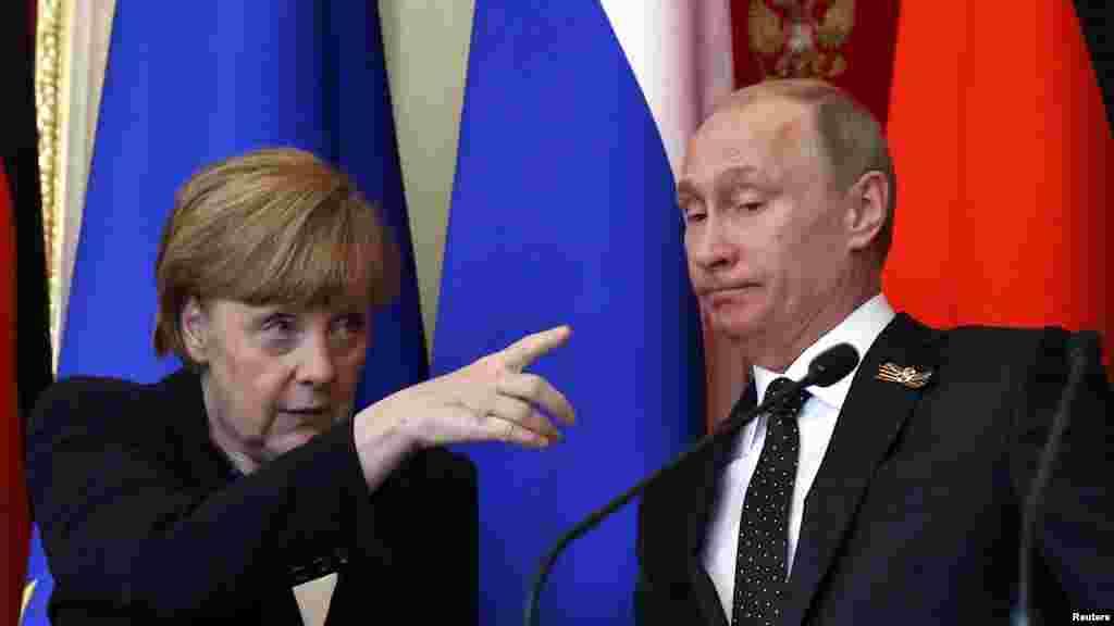 С канцлером Германии Ангелой Меркель после переговоров в Москве. Май 2015 года.