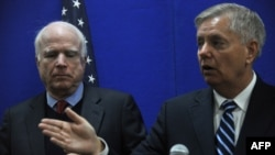 U.S. Senator Lindsey Graham (right) and Senator John McCain (left) both stopped short of calling for air strikes.