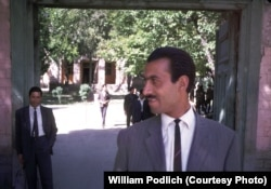 """The Higher Teachers College was a two-year institution for training college-level teachers, located at Seh Aqrab Road and Pul-e Surkh Road, on the west side of Kabul, near Kart-e Sei,"" recalls Peg Podlich. In this photograph, a Mr. Bahir (left), who was William Podlich's counterpart at the college, and an Afghan teacher pose outside the school."
