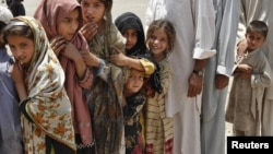 Children displaced by fighting await humanitarian aid in one of Pakistan's tribal districts. The government has failed to back its counterinsurgency with development efforts to win public support.