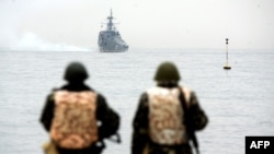 Ukraine -- Ukrainian marines look at a Russian ship floating out of the Sevastopol bay, March 4, 2014
