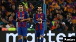 Barcelona's Luis Suarez and Lionel Messi look dejected after the match - 19.04.2017