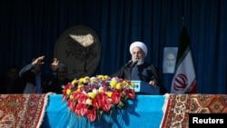 Iranian President Hassan Rouhani gives a public speech during a trip to the northern Iranian city of Shahroud, Iran, December 4, 2018. Official President website/Handout via REUTERS