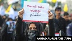 Žena na maršu u Bagdadu