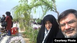 Parents of Mohsen Rouholamini visit the grave of their son, a protester in 2009 who dies in custody in Iran, undated.
