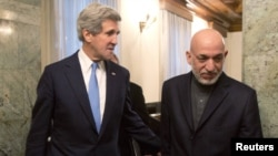 Afghan President Hamid Karzai (right) with US Secretary of State John Kerry (file photo)