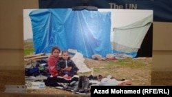 A photo displayed at an exhibition organized on World Refugee Day and dedicated to the plight of Syrian refugees, Sulaymaniya, iraq 19Jun2013