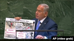 "Netanyahu addressing UN General Assembly, 2018: Iran has ""A secret atomic warehouse""."