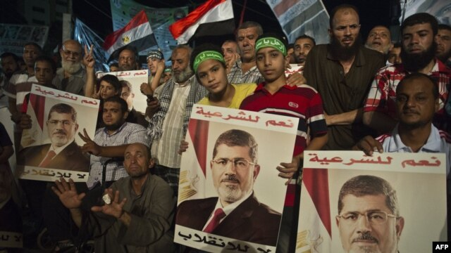Supporters of Egypt's deposed president, Muhammad Morsi, gather during their open sit-in outside Rabaa al-Adawiya Mosque in Cairo on August 1.