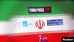The logos for the Yemen Press News Agency, Sudan Today, Nile Net Online and AWDnews websites are seen against an Iranian flag in a picture illustration taken November 29, 2018. Picture taken November 29, 2018. To match Special Report CYBER-IRAN/ REUTER