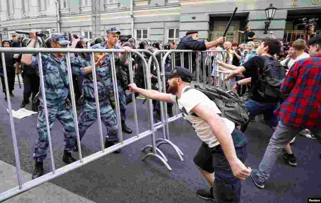 Scuffles took place in Moscow, where around 2,000 protesters reportedly started marching toward the Kremlin before being stopped by metal barriers and lines of police.