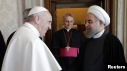 Iranian President Hassan Rohani (right) is welcomed by Pope Francis at the Vatican on January 26.