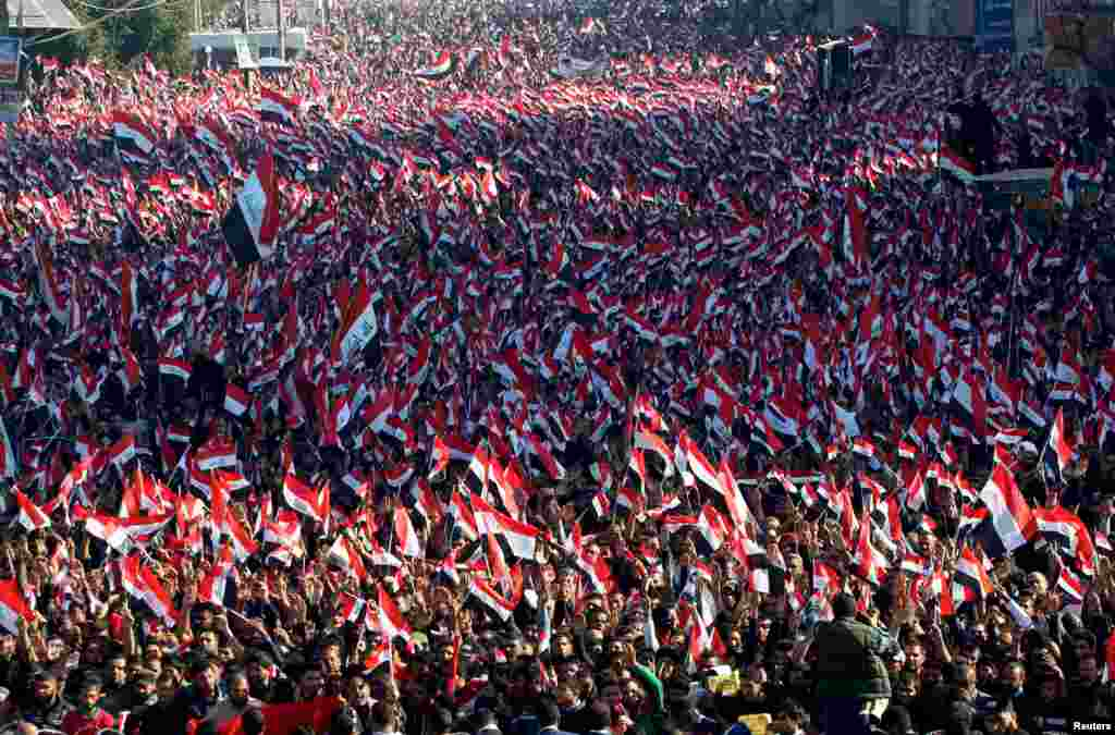 Supporters of prominent Iraqi Shi'ite cleric Moqtada al-Sadr shout slogans during a protest against corruption at Tahrir Square in Baghdad, Iraq, on February 26. (Reuters/Alaa Al-Marjani)