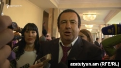 Armenia - Businessman Gagik Tsarukian, accompanied by Naira Zohrabian (L), speaks to reporters in the parliament in Yerevan,18May2017