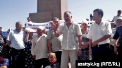 Demonstrators protesting the deployment of a temporary OSCE police force in southern Kyrgyzstan on July 26.