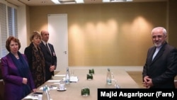 Шефот за надворешна политика на ЕУ, Кетрин Ештон и иранскиот министер за надворешни работи Мохамед Џавад Зариф.