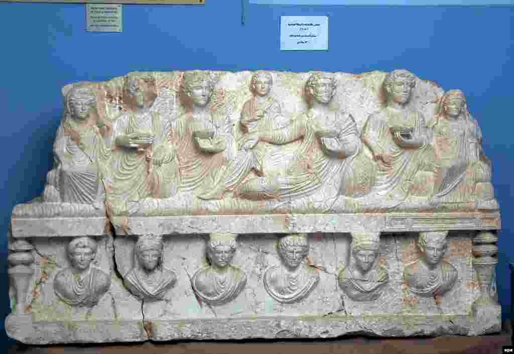 A 2nd century limestone relief excavated in 2008 from a cemetery in Palmyra. Shapes of 13 men and women, all from the same family, are engraved on it.