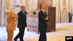 U.S. President Barack Obama (right) and U.S. Secretary of State Hillary Clinton tour the Sultan Hassan Mosque in Cairo on June 4.