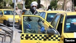 Taxi driver wearing protective mask against coronavirus in Kerman, Iran. FILE PHOTO