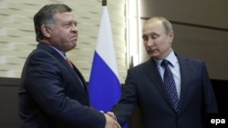Jordanian King Abdullah II (left) and Russian President Vladimir Putin in 2015 (file photo)