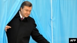Viktor Yanukovych emerges from a voting booth on February 7.
