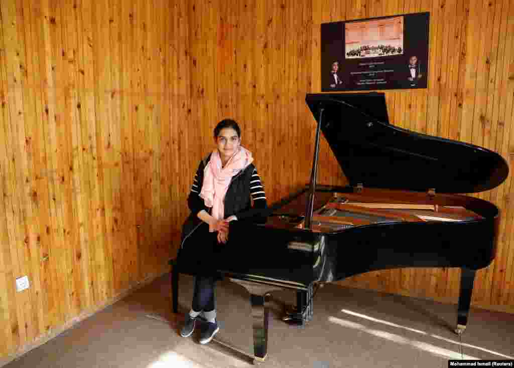 "Maram Atayee, 16, a pianist at the Afghan National Institute of Music, is concerned about a future role in government for the Taliban. ""The thing I'm most worried about is that if they return, I won't be able to continue playing music."""