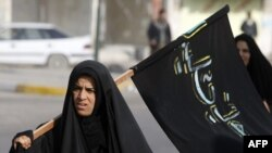 Carrying the Shi'ite banner in Iraq?