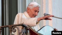 Pope Benedict XVI waves as he appears for the last time at the balcony of his summer residence in Castel Gandolfo