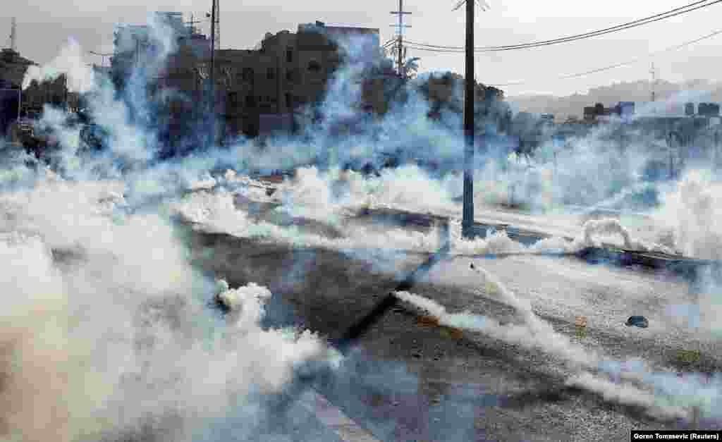 Israeli forces fire gas canisters at Palestinian protesters during a protest in the West Bank city of Bethlehem. (Reuters/Goran Tomasevic)