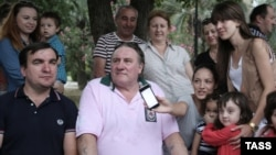 French-born actor and Russian passport holder Gerard Depardieu (center) meets with city residents in Sukhumi, in Georgia's breakaway republic of Abkhazia.