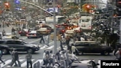 A surveillance photo shows a Nissan sports-utility vehicle (right) containing a bomb on Times Square in New York.