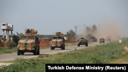 Turkish and Russian military vehicles take part in a joint patrol in the Idlib Province.