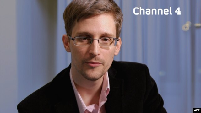 A recent, undated handout picture received from Channel 4 on December 24 shows U.S. intelligence leaker Edward Snowden preparing to make a televised Christmas message.