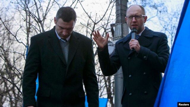 Opposition leaders Arseniy Yatsenyuk (right) and Vitali Klitschko speak during a rally in support of EU integration in front of the Cabinet of Ministers building in Kyiv last week