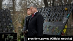 Ukrainian President Petro Poroshenko and his wife take part in a ceremony marking the fifth anniversary of the Euromaidan protests in Kyiv on November 21.