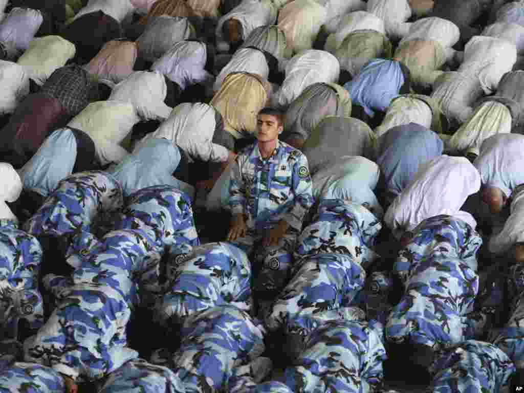 Iranian Air Force cadets, in uniform, perform Friday Prayers at Tehran University during the Muslim fasting month of Ramadan.Photo by Vahid Salemi for AP