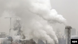 Ukraine -- Exhaust fumes from a heating plant rises in the air over Kyiv, 03Feb2012