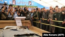Iranian Revolutionary Guards commander Major General Hossein Salami and General Amirali Hajizadeh head of IRGC aerospace division (on the right), are among those looking at debris from what Iran presented as a downed US drone. September 21, 2019