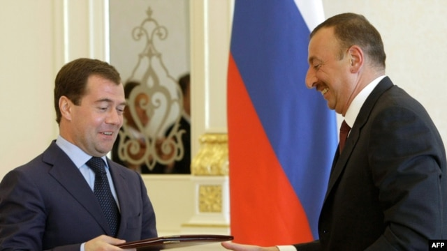 Russian President Dmitry Medvedev (left) at signing ceremony with Azerbaijani President Ilham Aliyev in Baku on June 29.