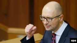 Ukrainian Prime Minister Arseniy Yatsenyuk addresses parliament ahead of a no-confidence vote in his leadership on February 16.