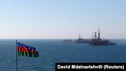 AZERBAIJAN -- Flag and oil platform in the Caspian Sea. January 22, 2013.